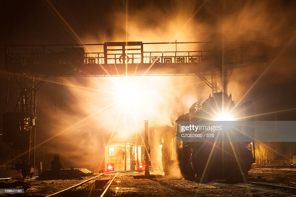 Old steam locomotive in action at night