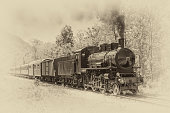 Old steam locomotive in vintage style