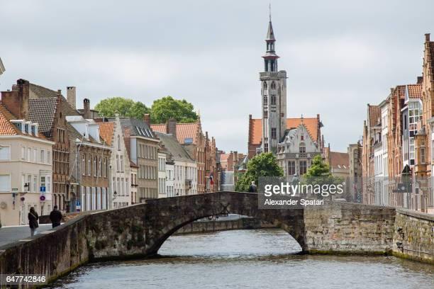 Old stone bridge across the canal in Bruges, West Flanders, Belgium