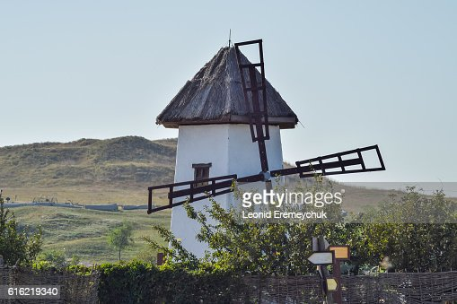 Old stone mill with a thatched roof : Stock Photo