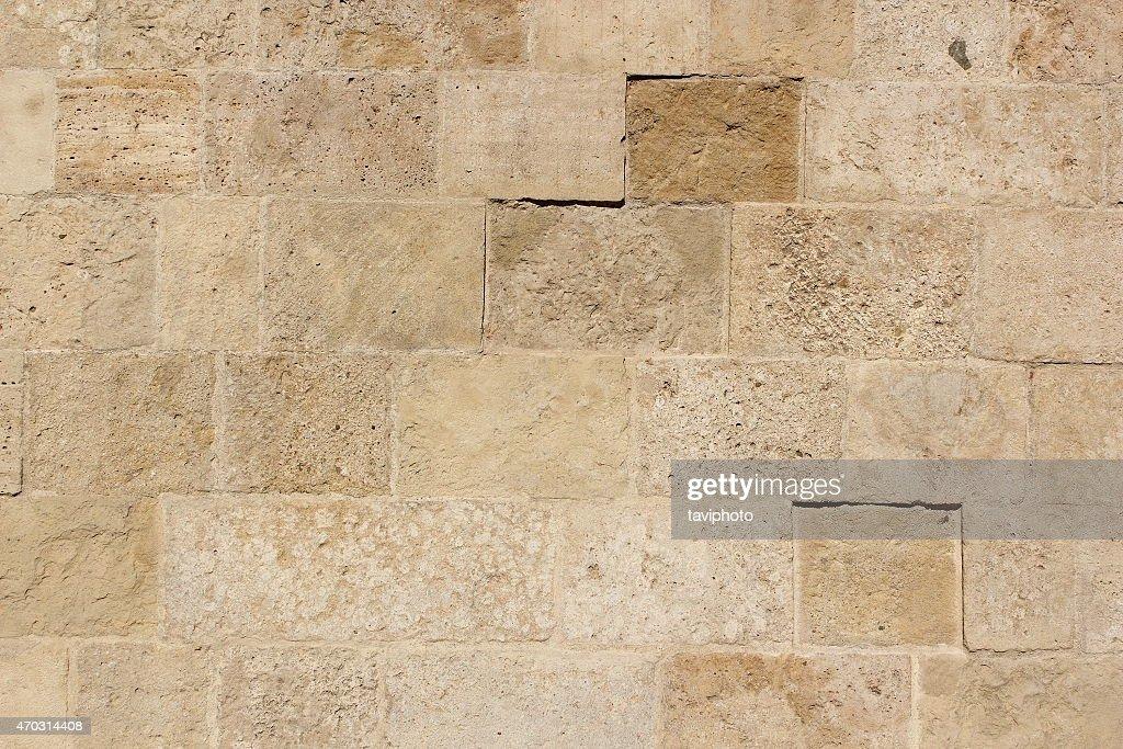 Primo piano di piastrelle di pietra beige trama di sfondo foto