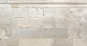 Old rough stone wall texture for background. Antik limestone
