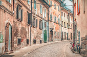 Side street with old, shabby buildings, yet colorful, located in the old city center of Ljubljana, the capital of Slovenia.