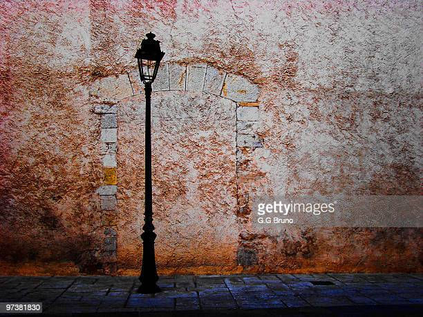 Old streetlamp, bricked door and old wall