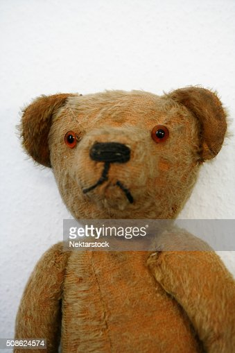 Old stuffed Teddybear rag doll : Stock Photo