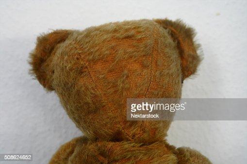 Old stuffed Teddybear rag doll : Stock Photo
