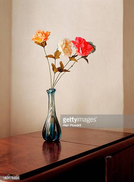 Old style vase of flowers in minimal room