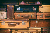 Old Suitcases Stacked On Top Of Each Other