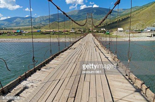 Old suspension bridge. Altai,  Russia. : Stock Photo