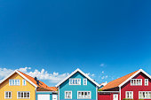 Colorful old swedish houses in front of a blue sky