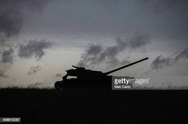 A old tank now used for military training is seen as people take part in the fifth annual carol service being held nearby inside the 13th century St...