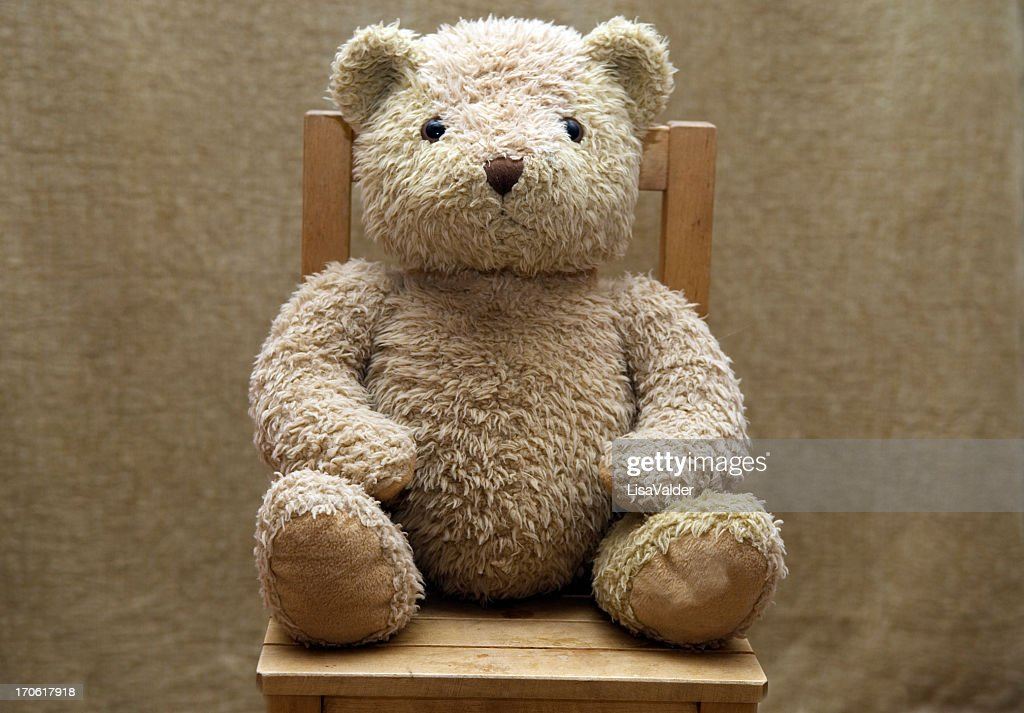 old teddy bear sitting on wooden chair stock photo getty images. Black Bedroom Furniture Sets. Home Design Ideas