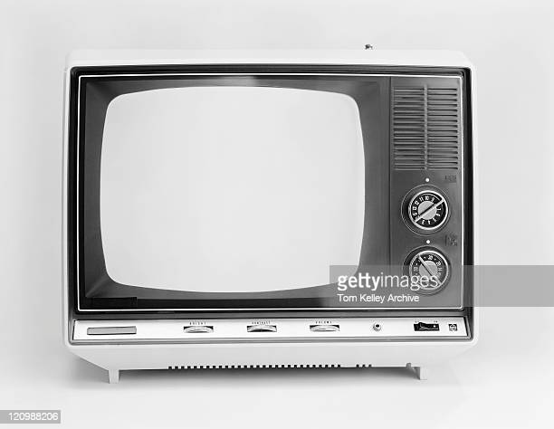 Old television set on white background, close-up