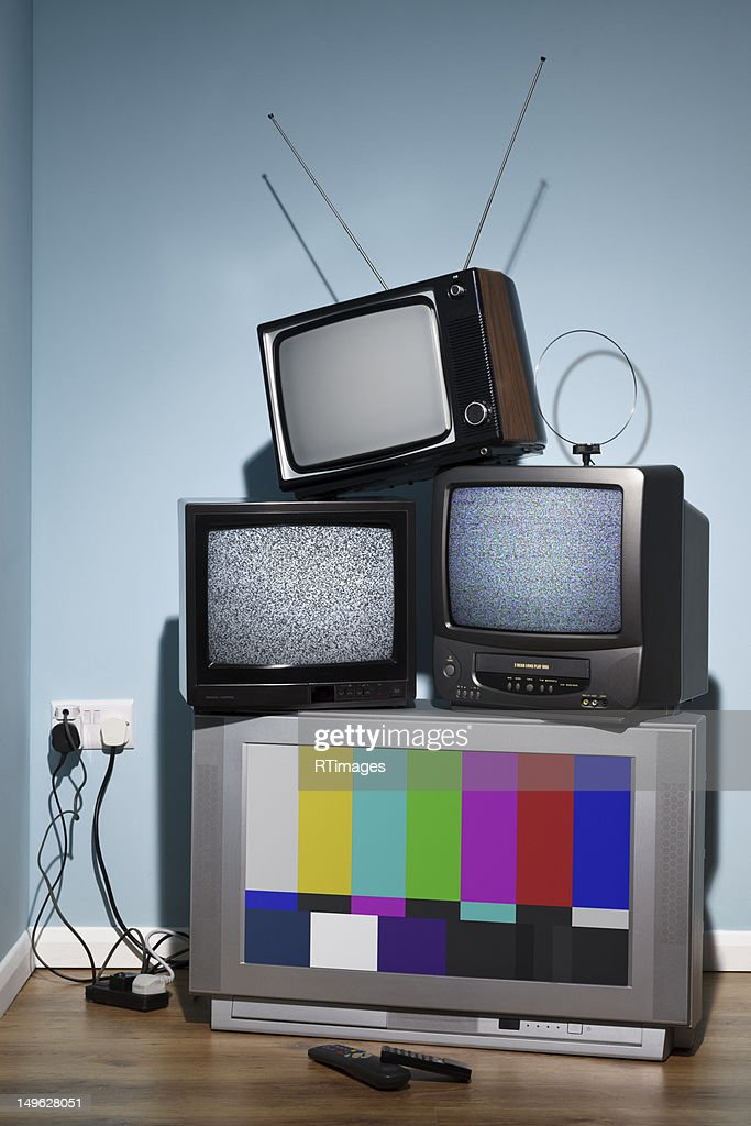 Old televisions in the corner of a room : Stock Photo