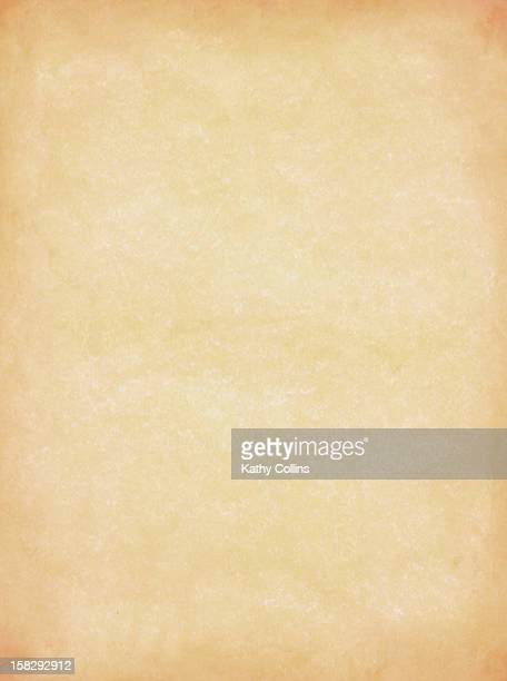 Old textured parchment with discoloured edges