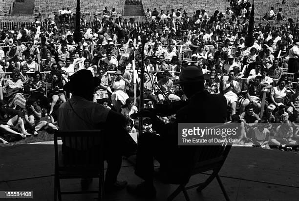 Old time blues and gospel string band musicians Willie B Thomas and Butch Cage perform at the Newport Folk Festival in June 1960 in Newport Rhode...