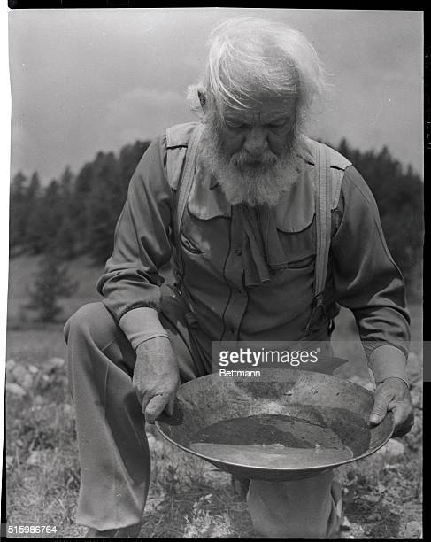 Old time gold prospector with pan in hands Black Hills South DakotaHis name is Ed Ryan Undated photo