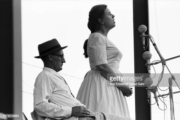 Old timey singer banjo player and guitarist Roscoe Holcomb and folk singer and dulcimer player Jean Ritchie share the stage at the Newport Folk...