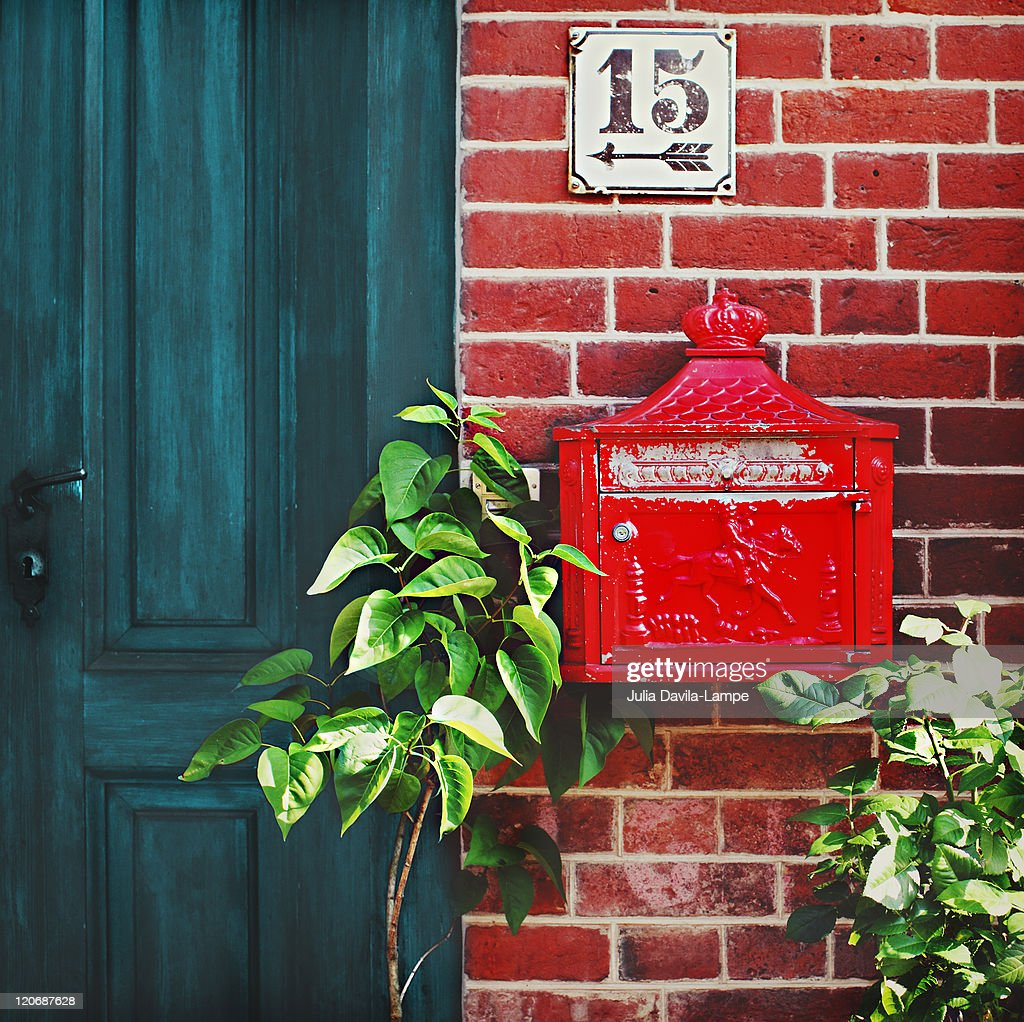 Old, tiny red letterbox : Stock Photo