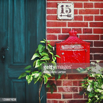 Old, tiny red letterbox