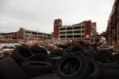 Old tires rest near the abandoned Packard Automotive Plant December 13 2013 in Detroit Michigan Perubased developer Fernando Palazuelo made his final...