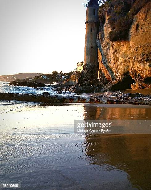 Old Tower Against Cliff On Seaside