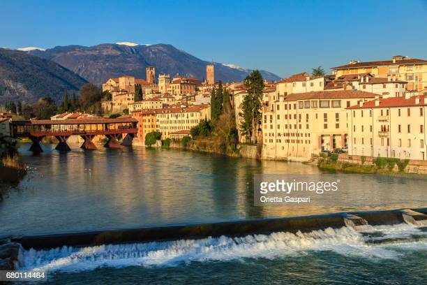 Old town of Bassano del Grappa along the river Brenta with the famous Ponte degli Alpini. Province of Vicenza, Italy