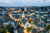 Aerial view over the old town of Siegen at dusk. North Rhine-Westphalia, Germany