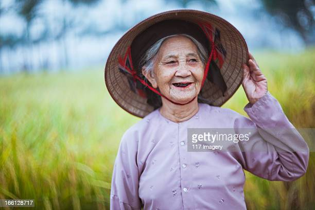 Old traditional vietnamese woman in conical style