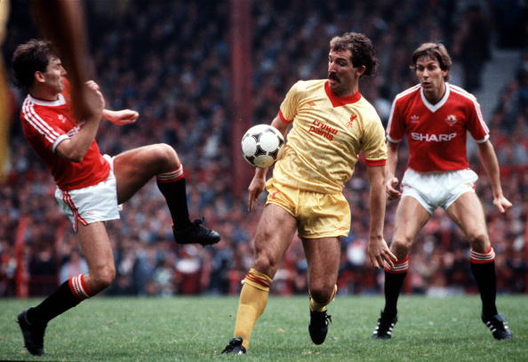 Old Trafford, Manchester. Manchester United v Liverpool. Liverpool's Graeme Souness is challenged by Manchester United's Bryan Robson, as Arnold Muhren looks on. : News Photo