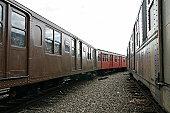 old trains at a railroad yard
