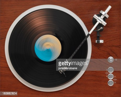 Old turntable playing record