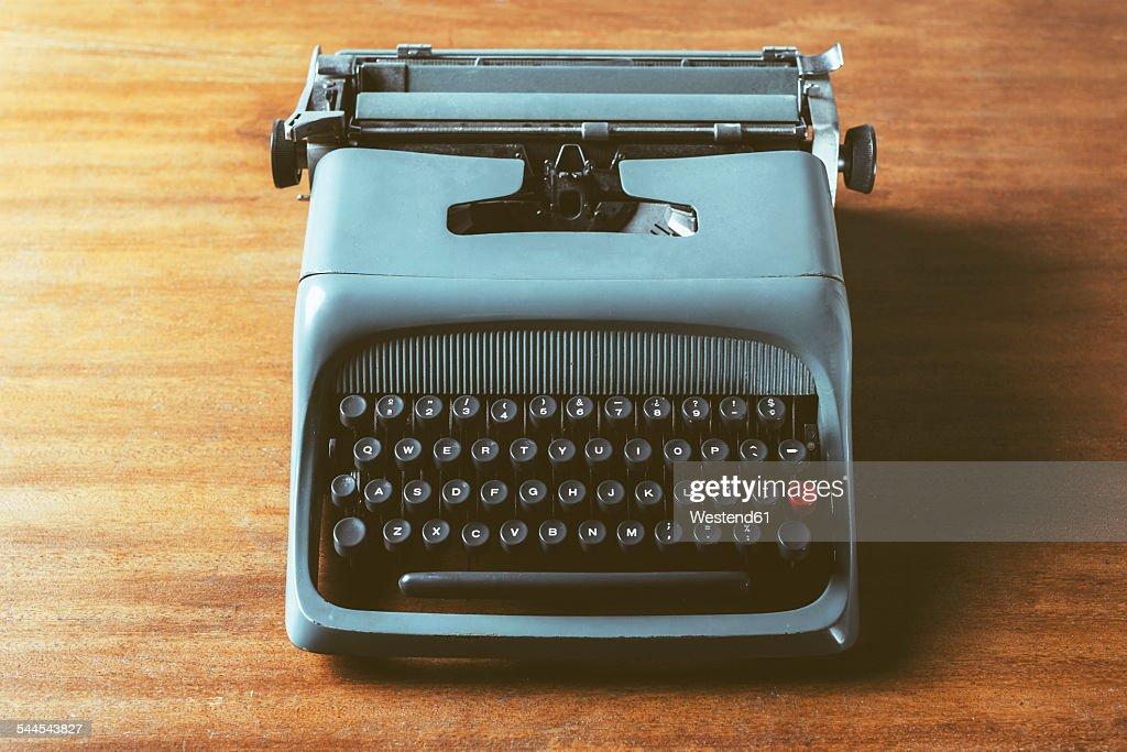 Old typewriter on wood