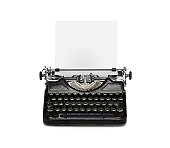 Retro rusty typewriter with paper sheet isolated on white background