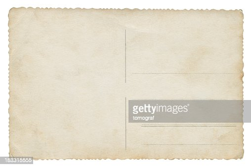 A old unmarked postcard sits on a white background