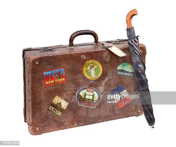 Alte Koffer mit Regenschirm verwendet