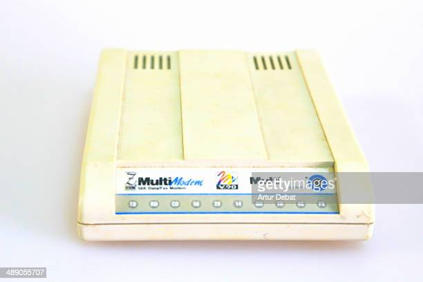 Old useless 56k modem with white background