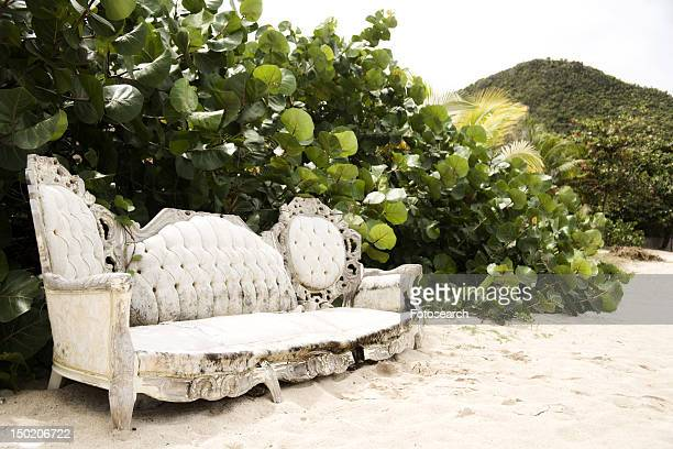 Old Victorian sofa outside on beach
