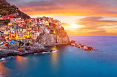Old village Manarola, Cinque Terre coast, Italy. Beautiful sunset view