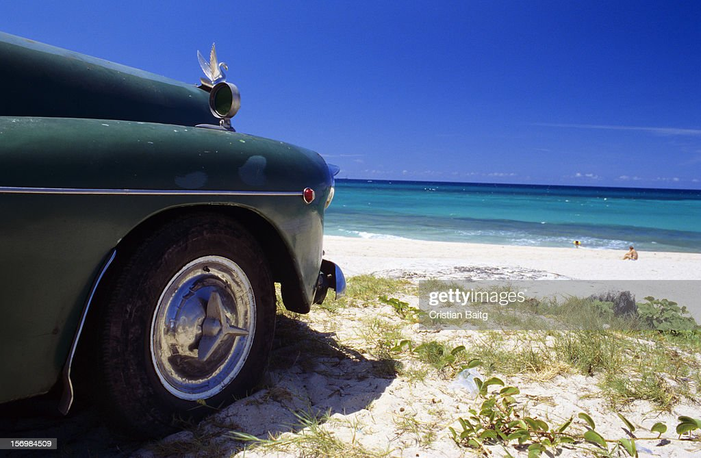 Old vintage car at one of the east beaches of Havana Cuba.