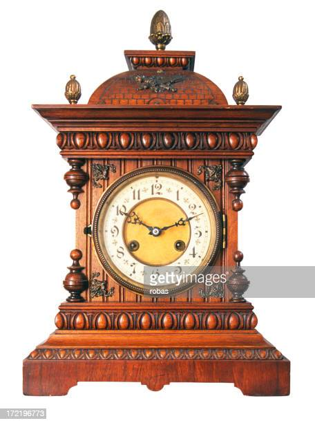 Old vintage clock with wooden ornaments