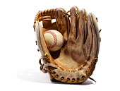 Old vintage leather baseball glove with the baseball held in the palm by the thumb standing upright on a white background