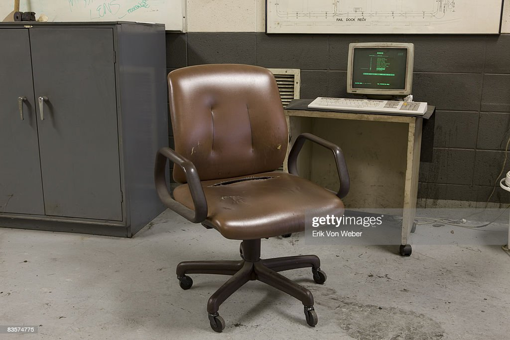 old vinyl chair and computer in factory