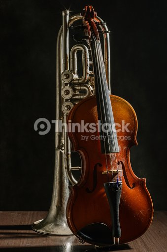 Old Violin And Trumpet On A Black Background Stock Photo