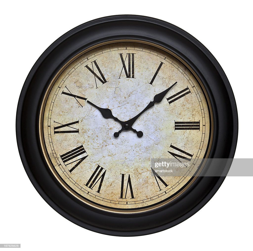 Old Wall Clock With Roman Numerals