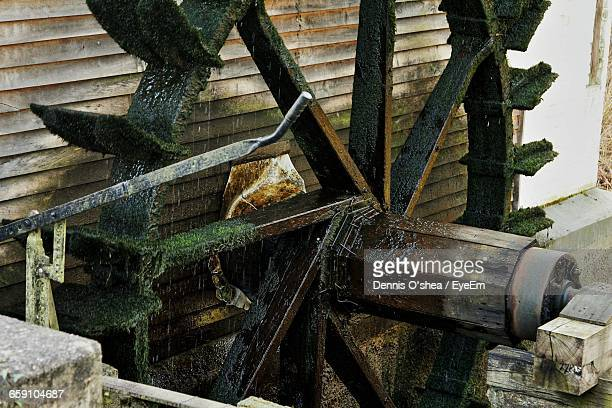 Old Water Wheel By Wall