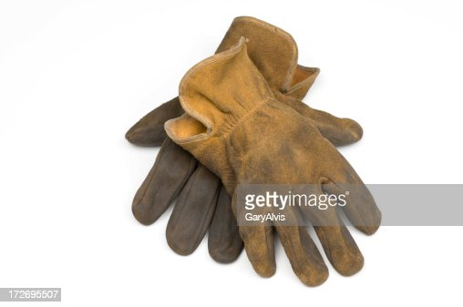 Old well worn leather work gloves-isolated on white
