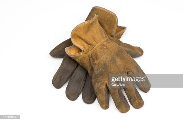 Old well worn leather Arbeit Handschuhe-isoliert auf weiss