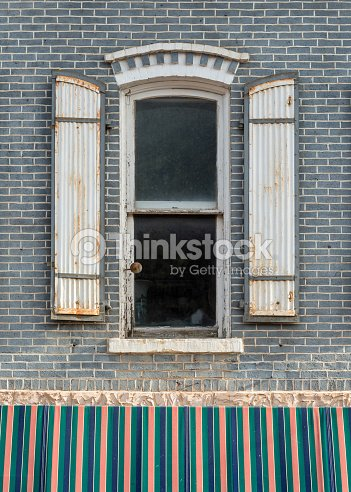 Old western window with shutters stock photo thinkstock old western window with shutters stock photo sisterspd
