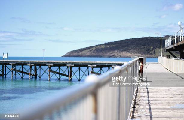 Old wharf with clear sky and calm ocean